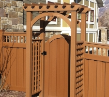 A picture of a pergola and gate